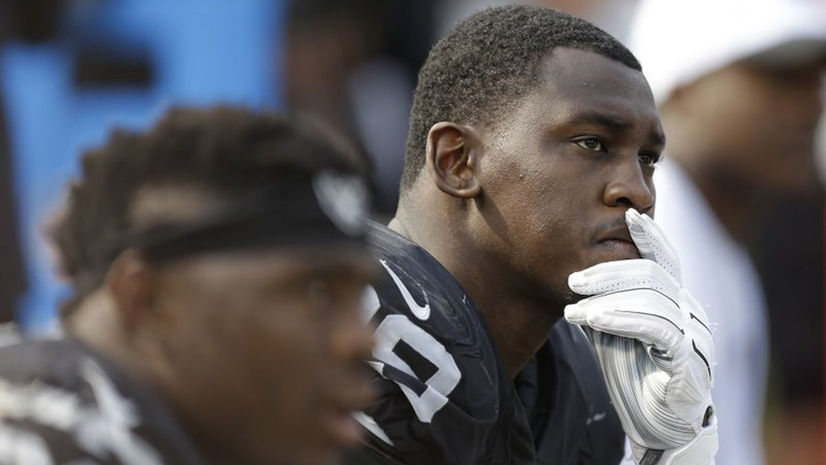 In this Sept. 13, 2015, file photo, Oakland Raiders linebacker Aldon Smith (99) sits on the bench during the second half of the team's NFL football game against the Cincinnati Bengals in Oakland, Calif. Smith will be able to take part in team activities with the Dallas Cowboys after the NFL on Wednesday, May 20, 2020, conditionally reinstated the pass rusher from an indefinite suspension for off-field issues. (AP Photo/Ben Margot, File)