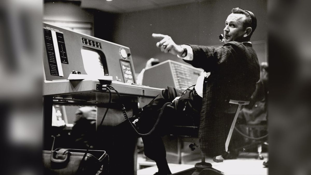 In this undated photo provided by NASA, Christopher Kraft, flight director during Project Mercury, works at his console inside the Flight Control area at Mercury Mission Control, in Houston. Kraft, the founder of NASA's mission control, died Monday, July 22, 2019, just two days after the 50th anniversary of the Apollo 11 moon landing. He was 95. | Photo Source: NASA via AP