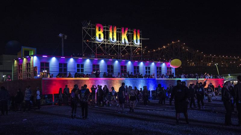 Festival goers attend the 2018 BUKU Music + Art Project at Mardi Gras World on Saturday, March...