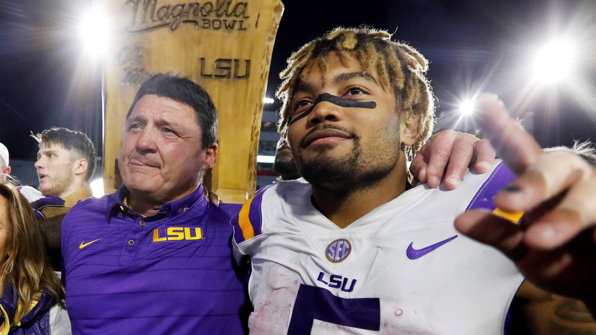 FILE - In this Oct. 21, 2017, file photo, LSU head coach Ed Orgeron, left, celebrates with...