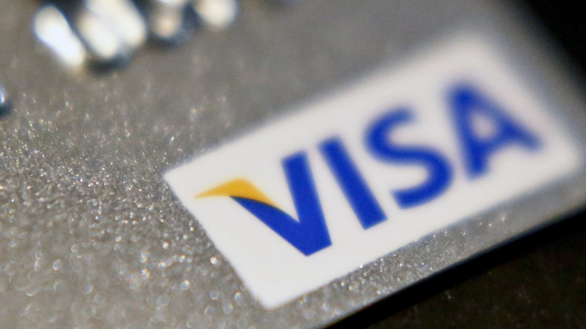 FILE- This June 13, 2018, file photo shows a Visa logo on a credit card in Zelienople, Pa. Visa...