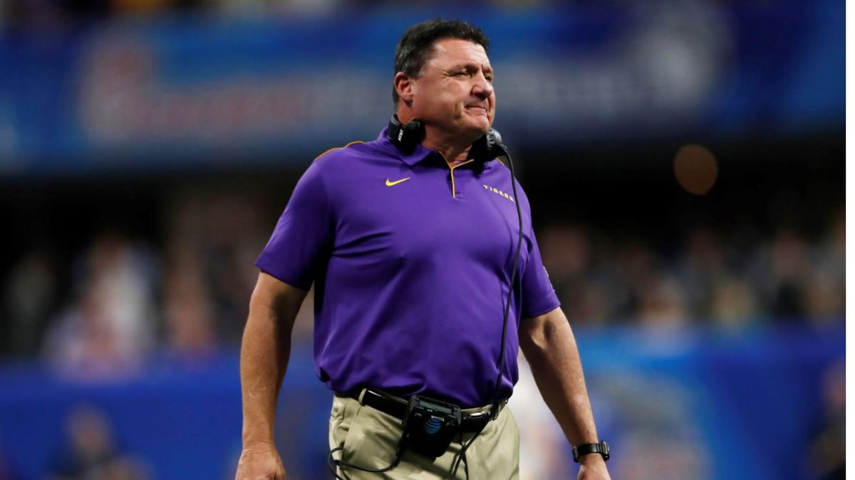 LSU coach Ed Orgeron waits for players during the first half of the Peach Bowl NCAA semifinal college football playoff game against Oklahoma, Saturday, Dec. 28, 2019, in Atlanta. | Source: AP Photo / John Bazemore