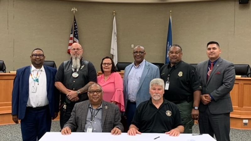 Tunica Biloxi Chairman Marshall Pierite (L) sits beside Avoyelles Parish Police Jury President...