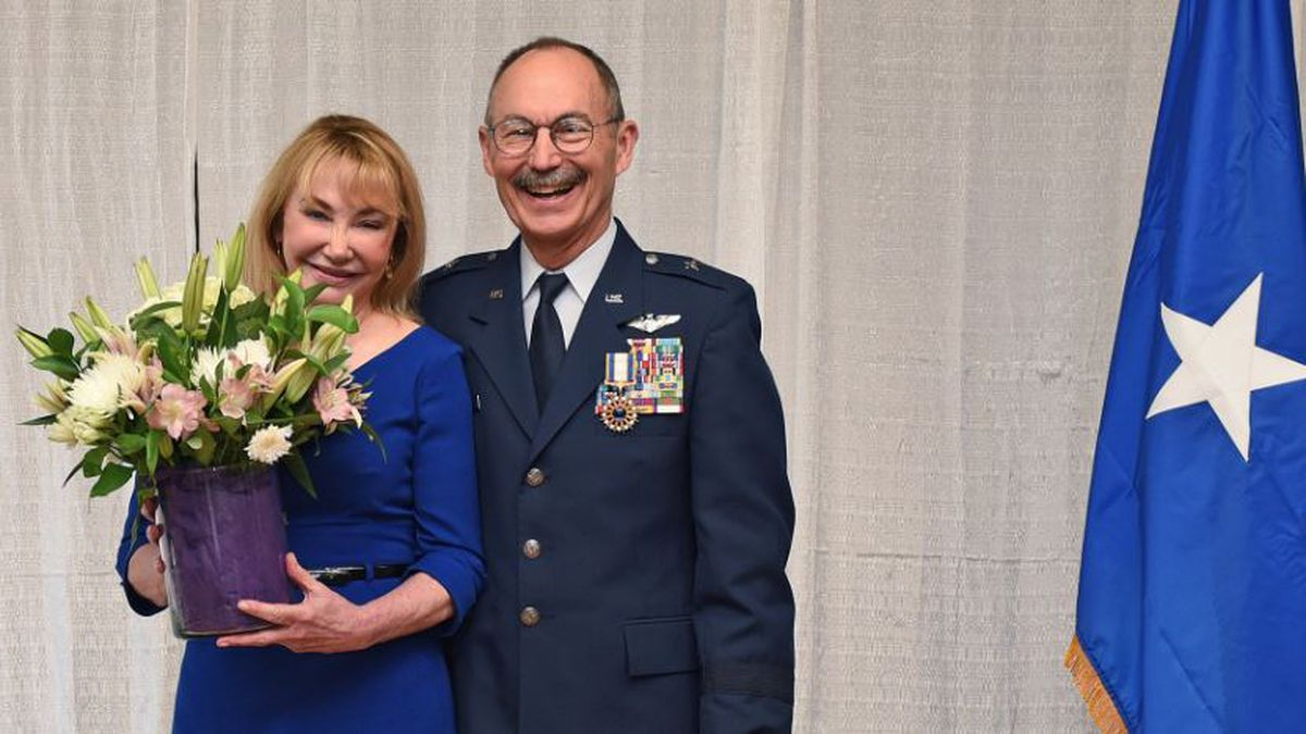 Dr. Cynthia Glass, Brig. Gen. Charles Chappuis' wife, receives flowers as a symbol of appreciation for her years of dedication to her husband during a retirement ceremony at Naval Air Station - Joint Reserve Base New Orleans, Jan. 12, 2019. Chappuis has served in the LANG since 1998 and was recognized for his 20 years of exceptional service. (U.S. Air National Guard photo by Staff Sgt. Cindy Au)