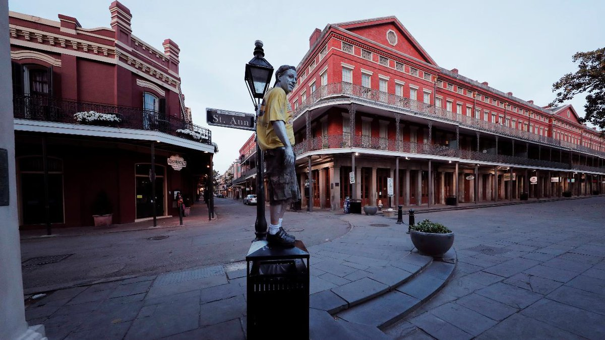 Street performer Eddie Webb looks around the nearly deserted French Quarter looking to make...